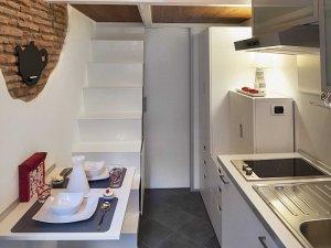 italian-micro-loft-dining-stairs